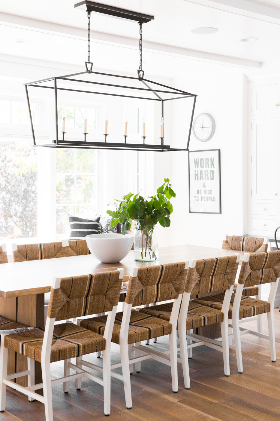 Modern metal chandelier above dining table