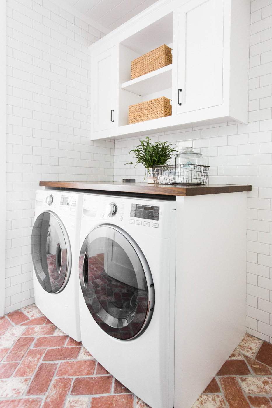 A white washer and dryer beneath counter