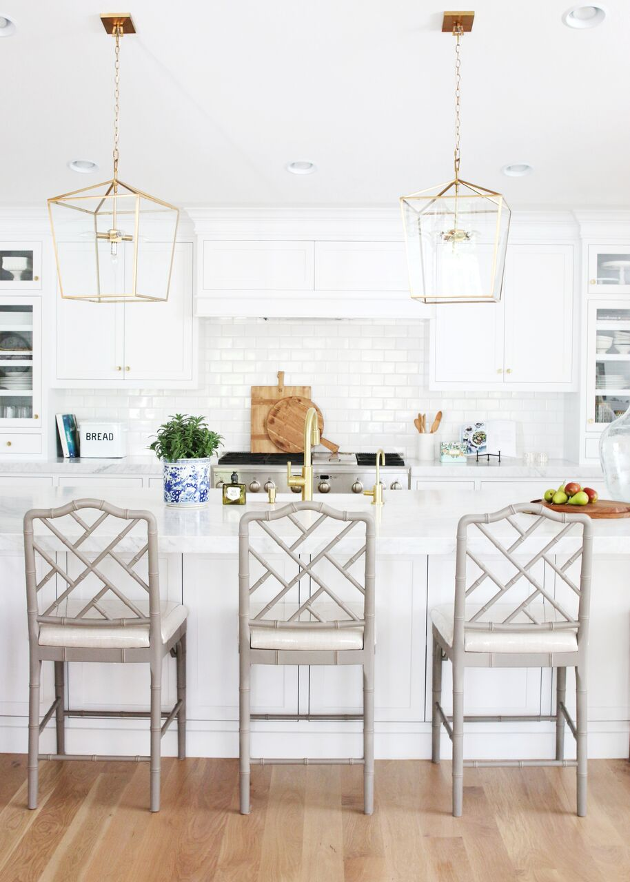 Three tall stools lined up against kitchen bar