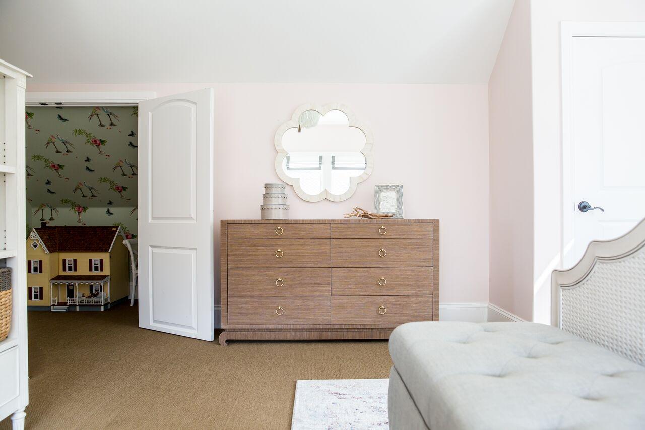 wood dresser beside closet doors