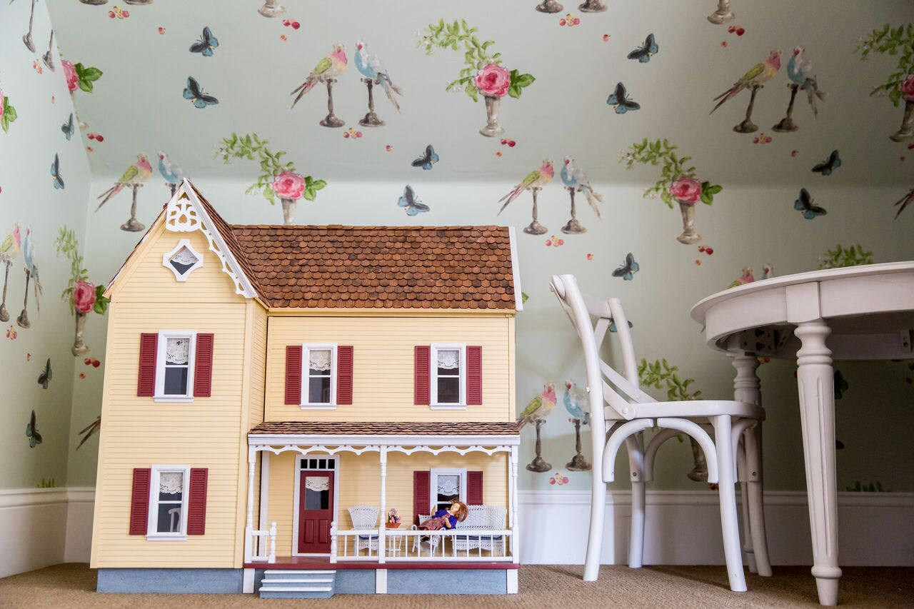 dollhouse and table in playroom