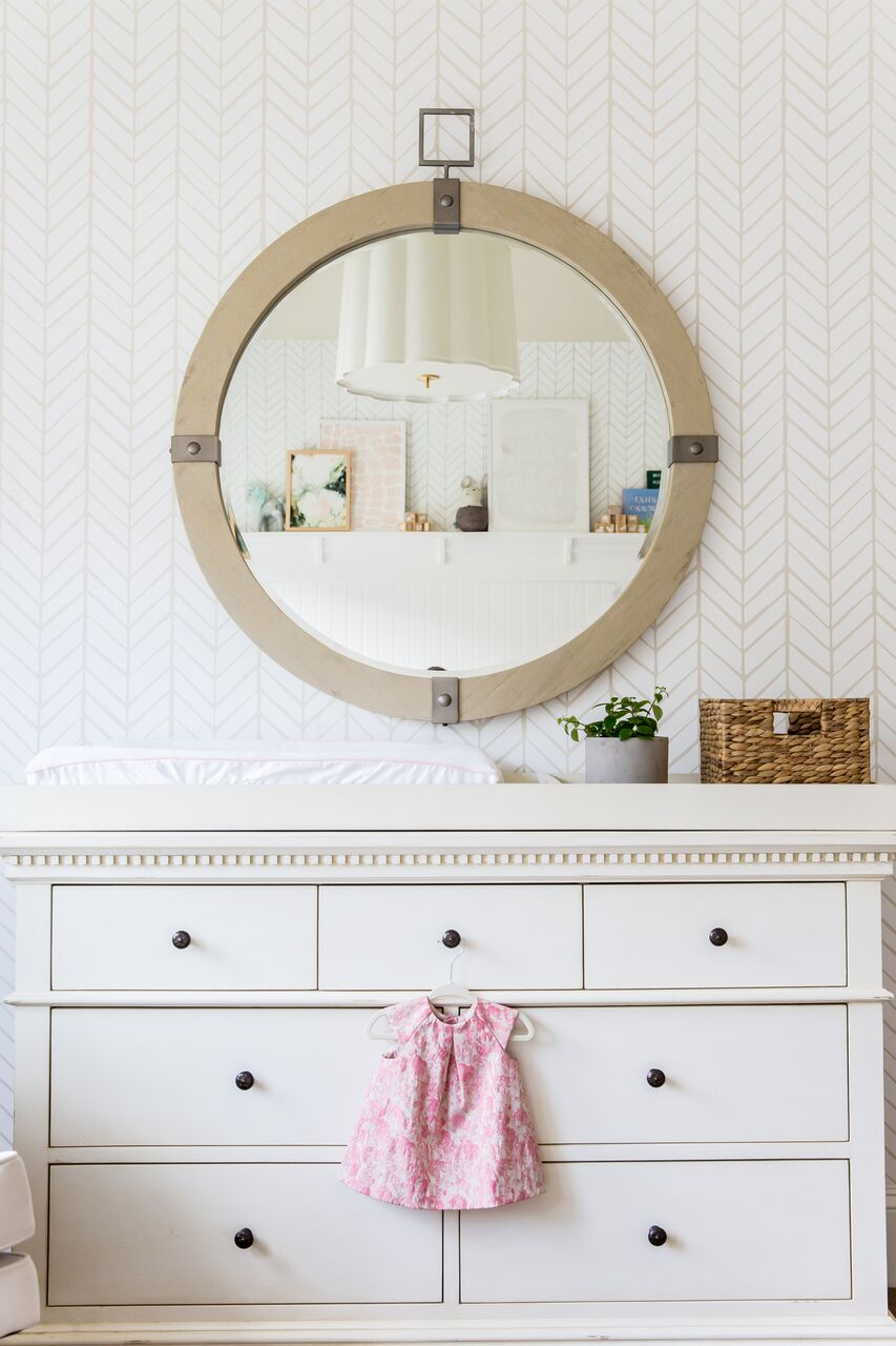 White dresser with pink dress in front