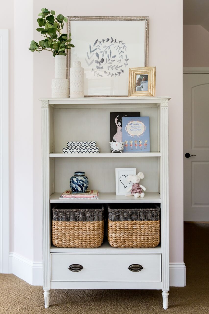 White stand alone shelf in bedroom