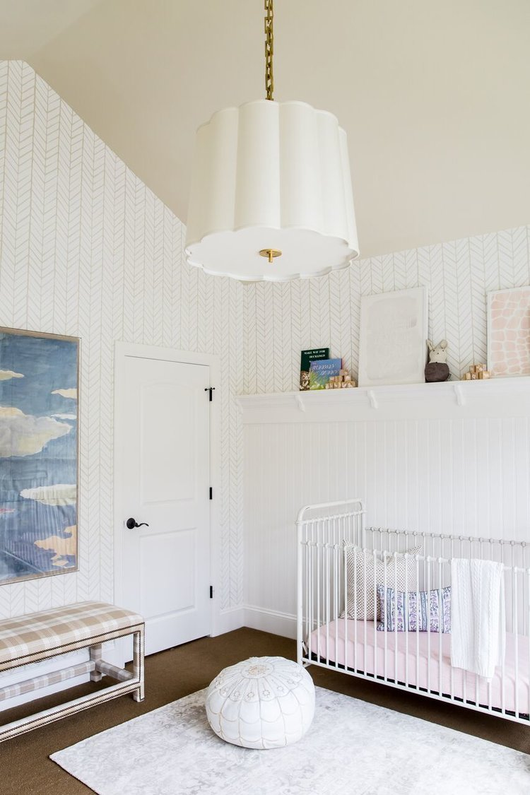Modern child's nursery with white accents