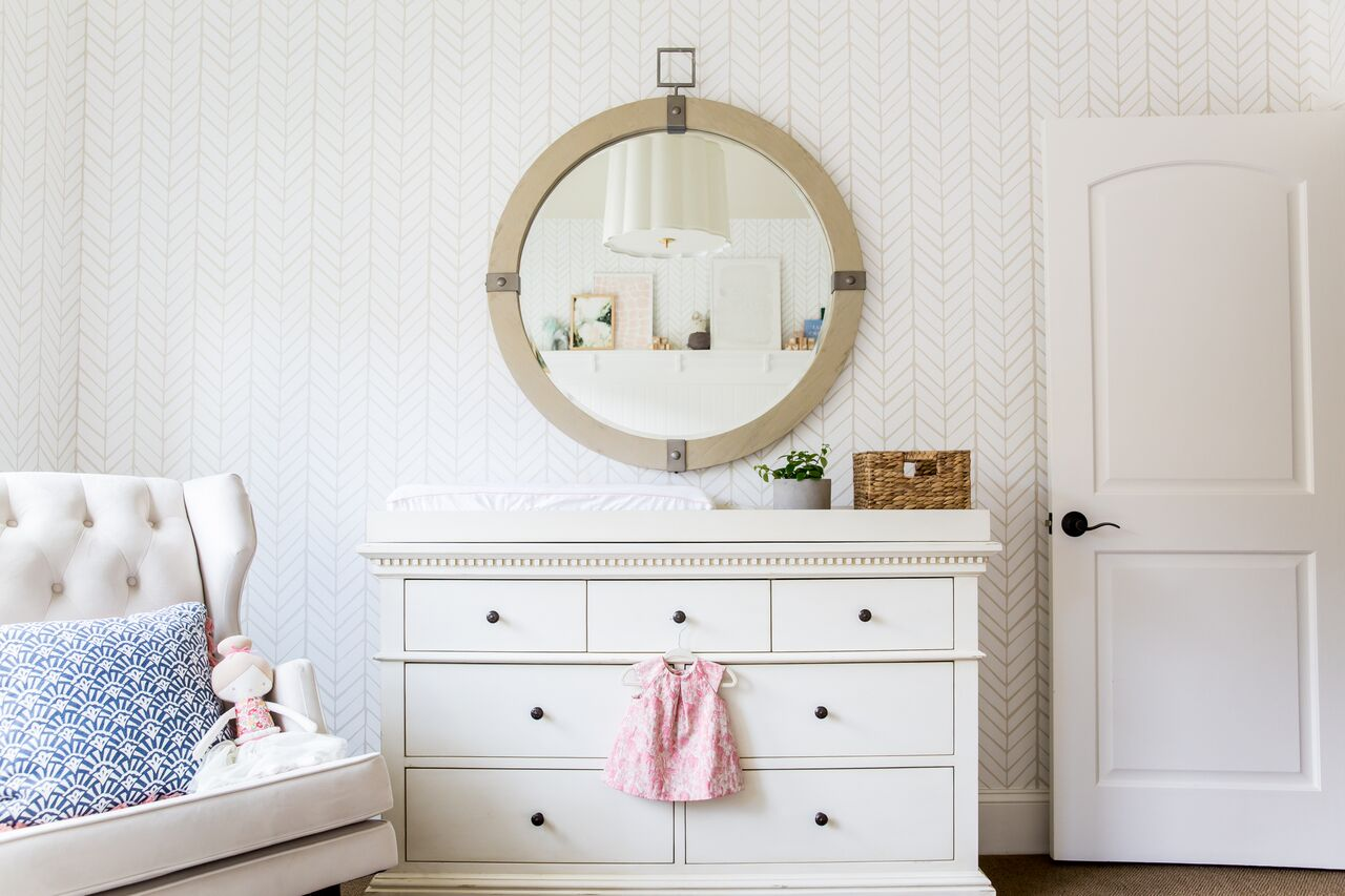White low dresser with circle mirror above