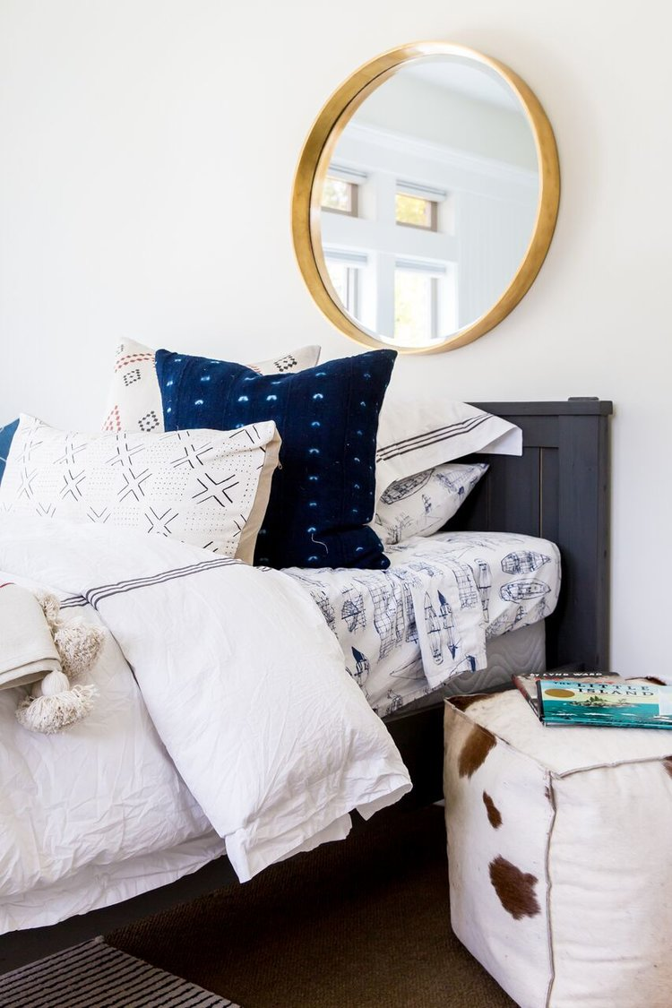 White nightstand next to twin bed