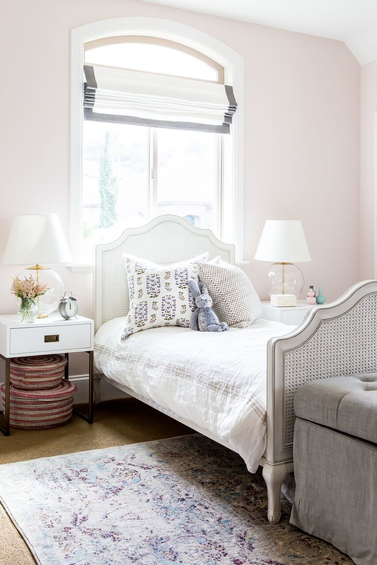 White twin bed with white headboard and footboard