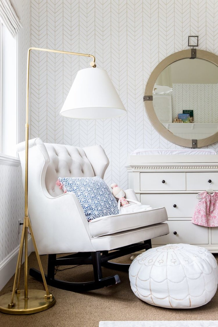 White sofa couch beside floor lamp