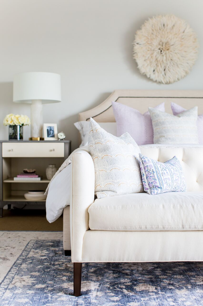 White lounge couch and bed on blue area rug
