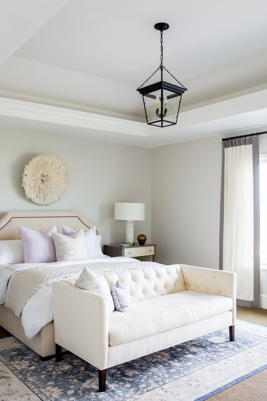 White lounge couch at foot of bed