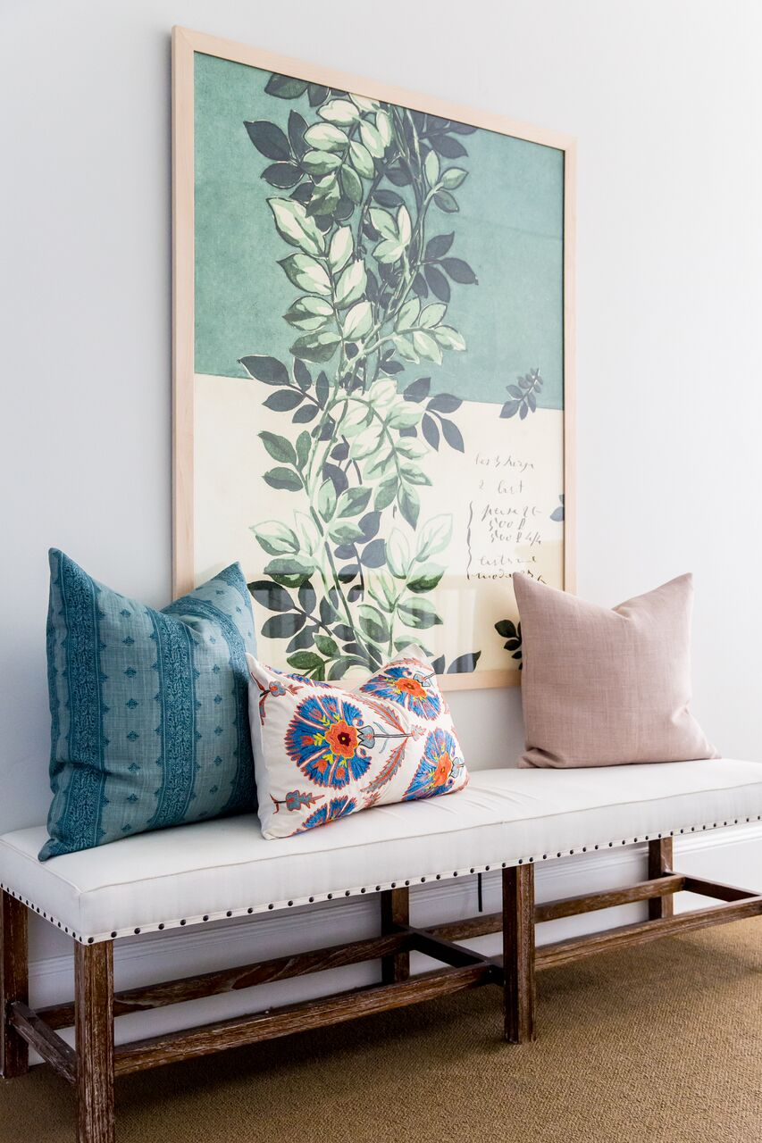 White bench with decorative pillows