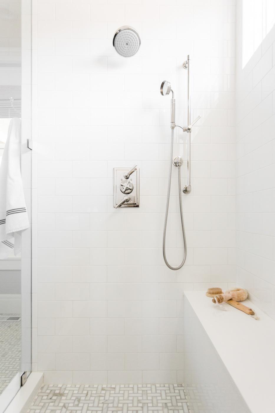Silver faucet details on bathroom shower