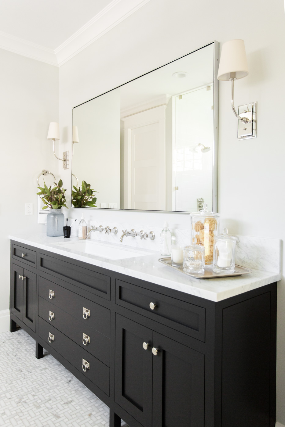Large back mirror above vanity