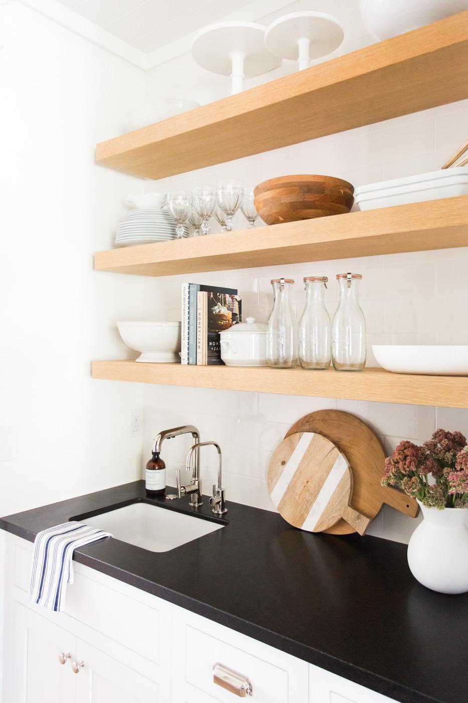 Wooden built in shelves above sink