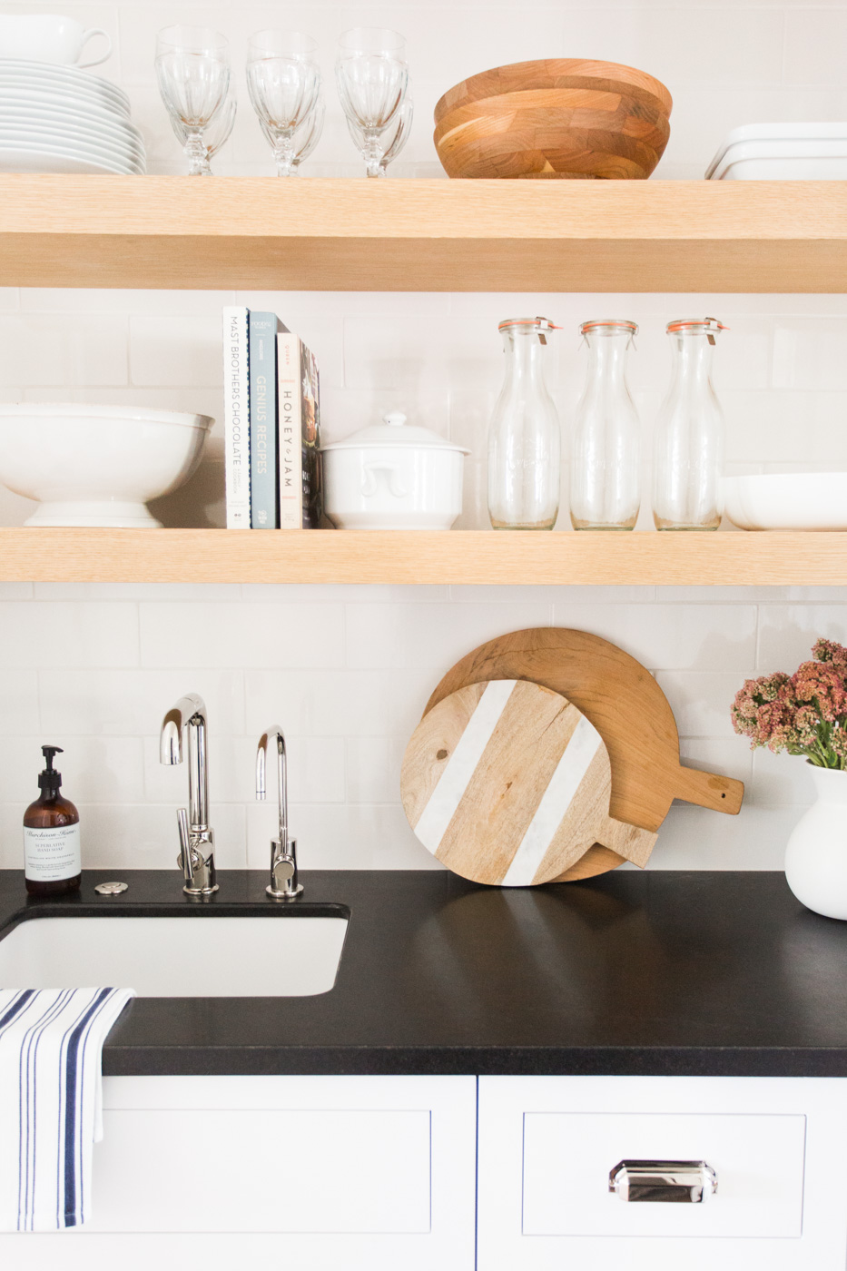 Glasses and cutting boards atop counter