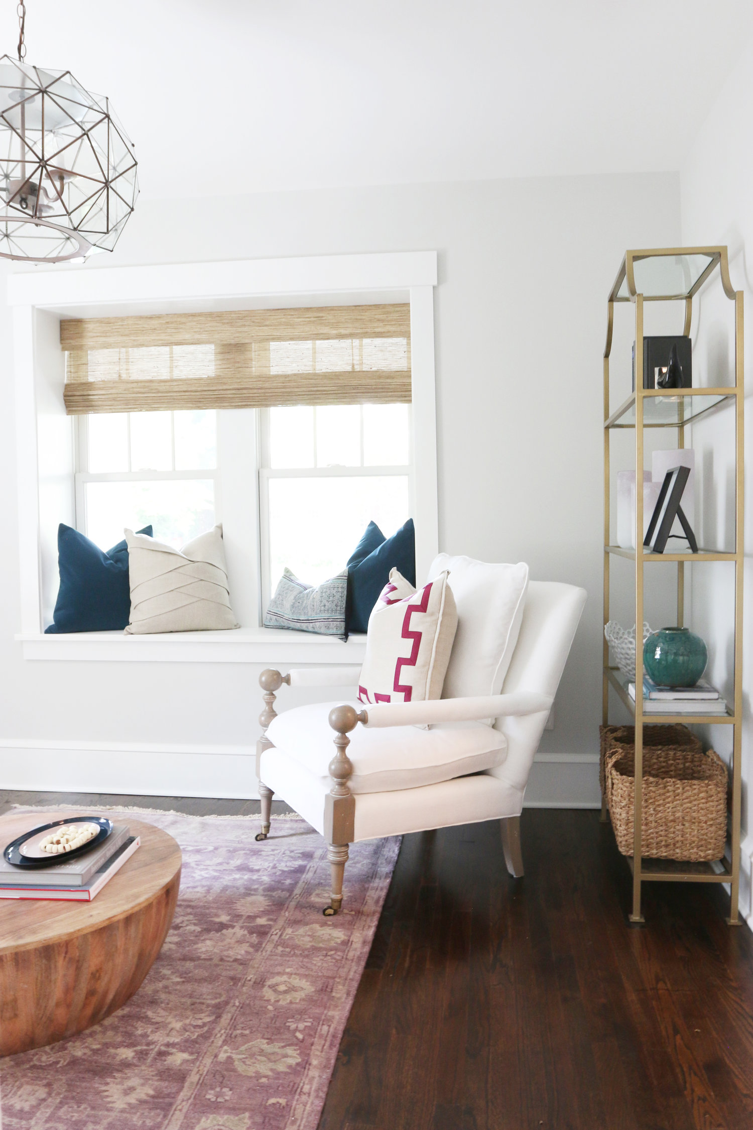 Side of white chair and daybed in living room