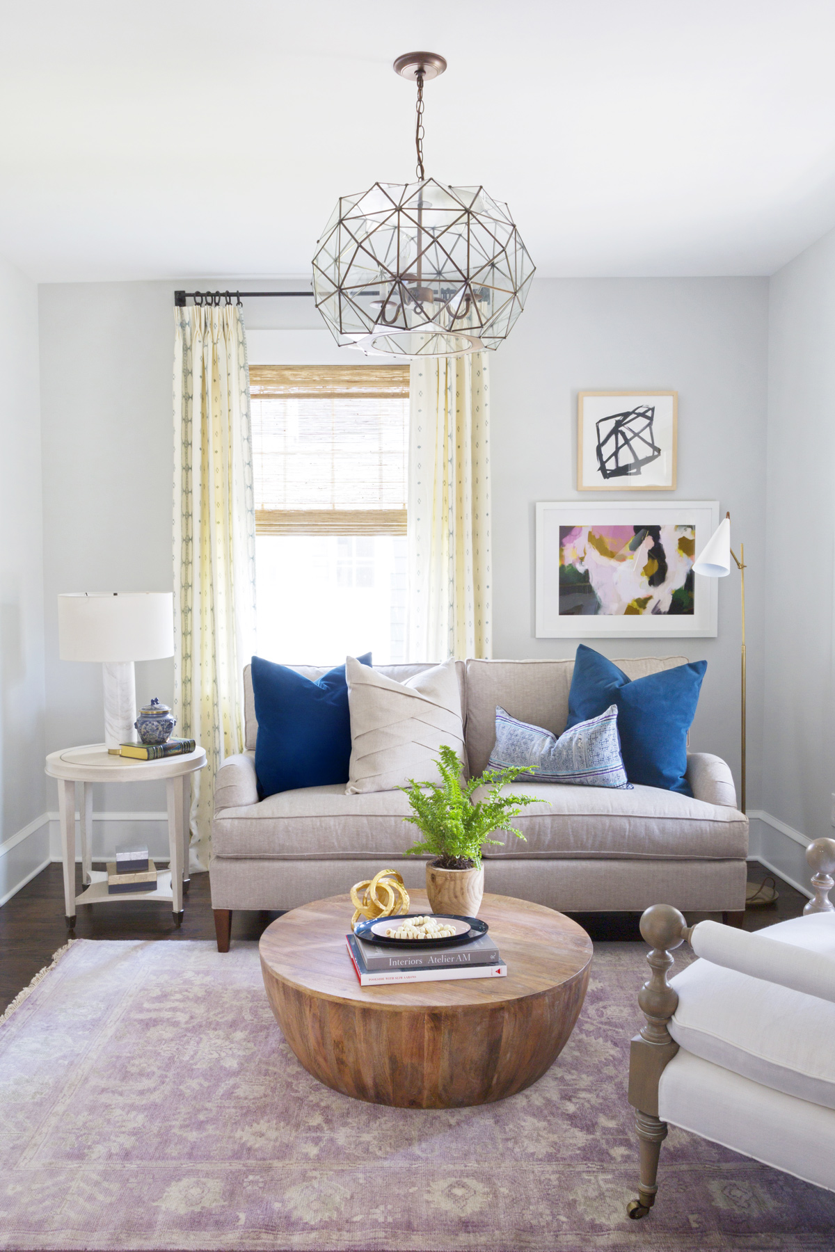 Front of grey sofa with round coffee table