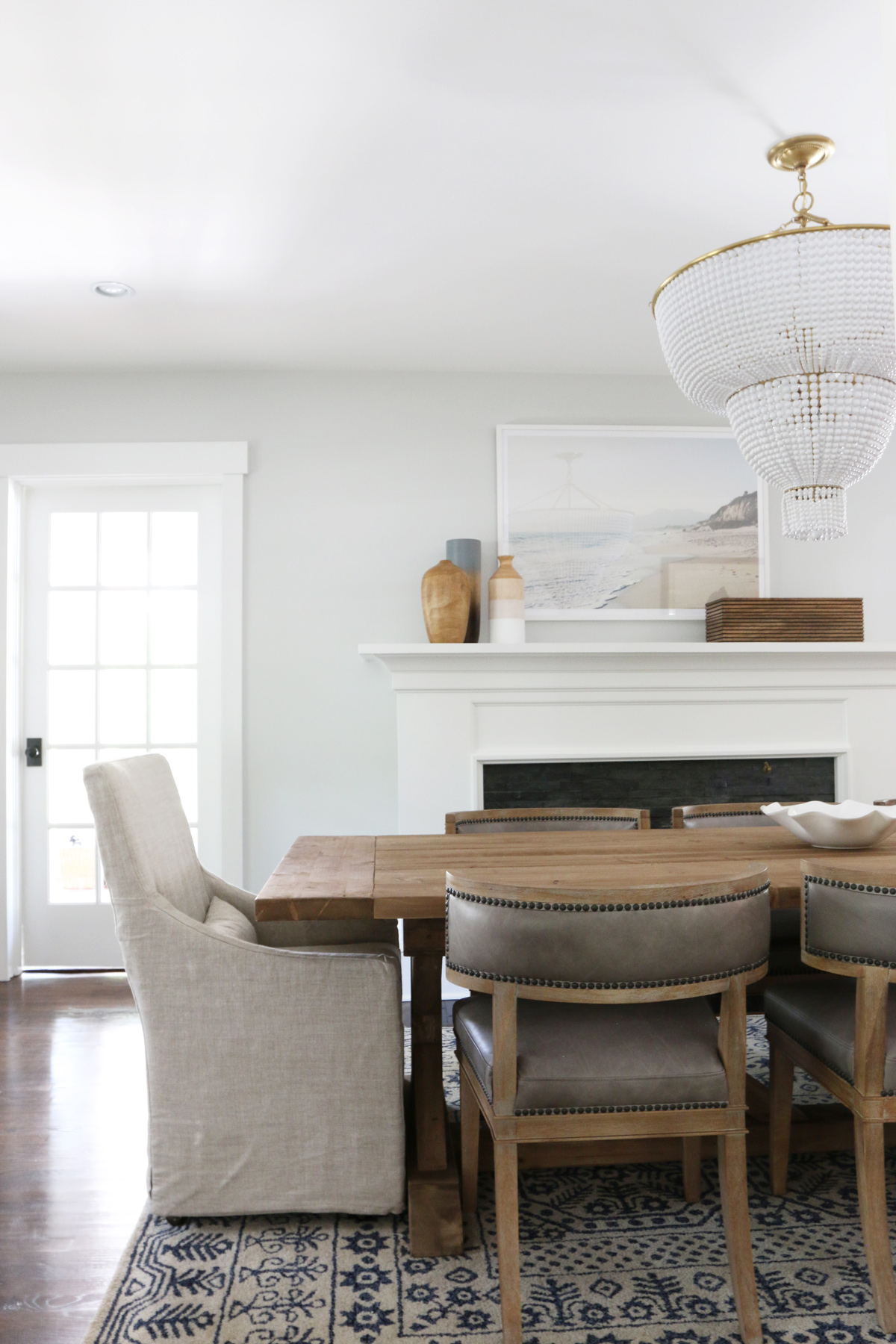 White head chair at the end of dining table