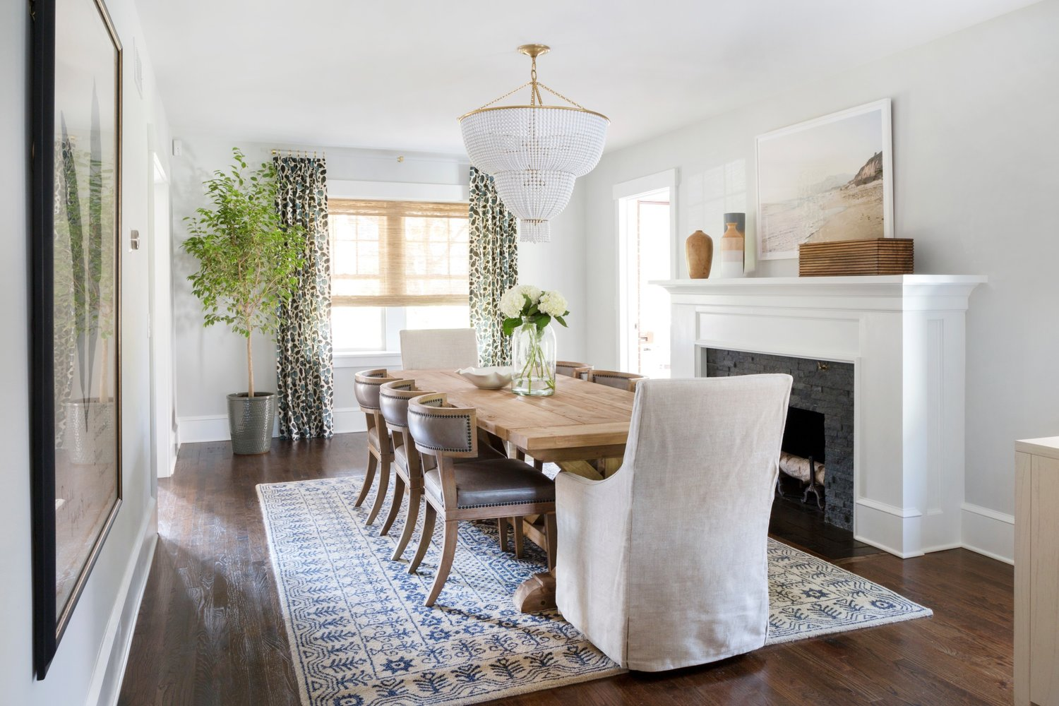 White chandelier above long dining table