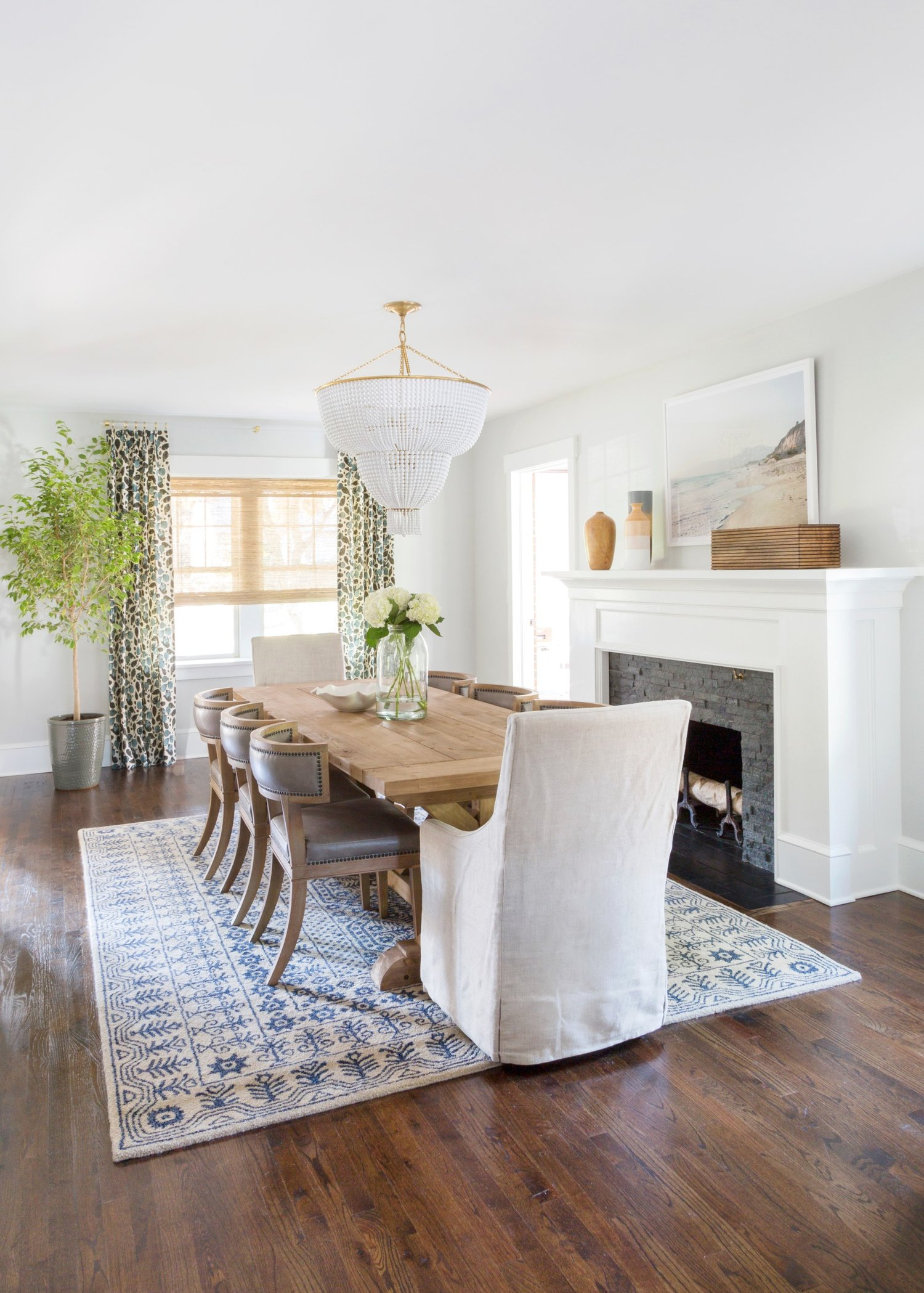 Long dining room table on blue and white rug
