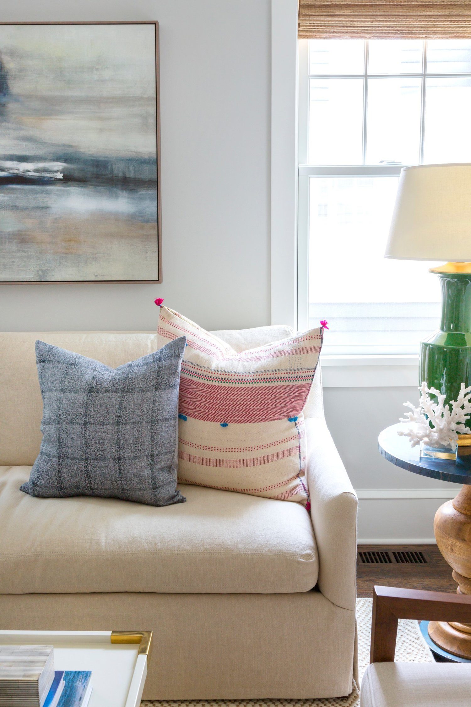 White couch with decorative pillows