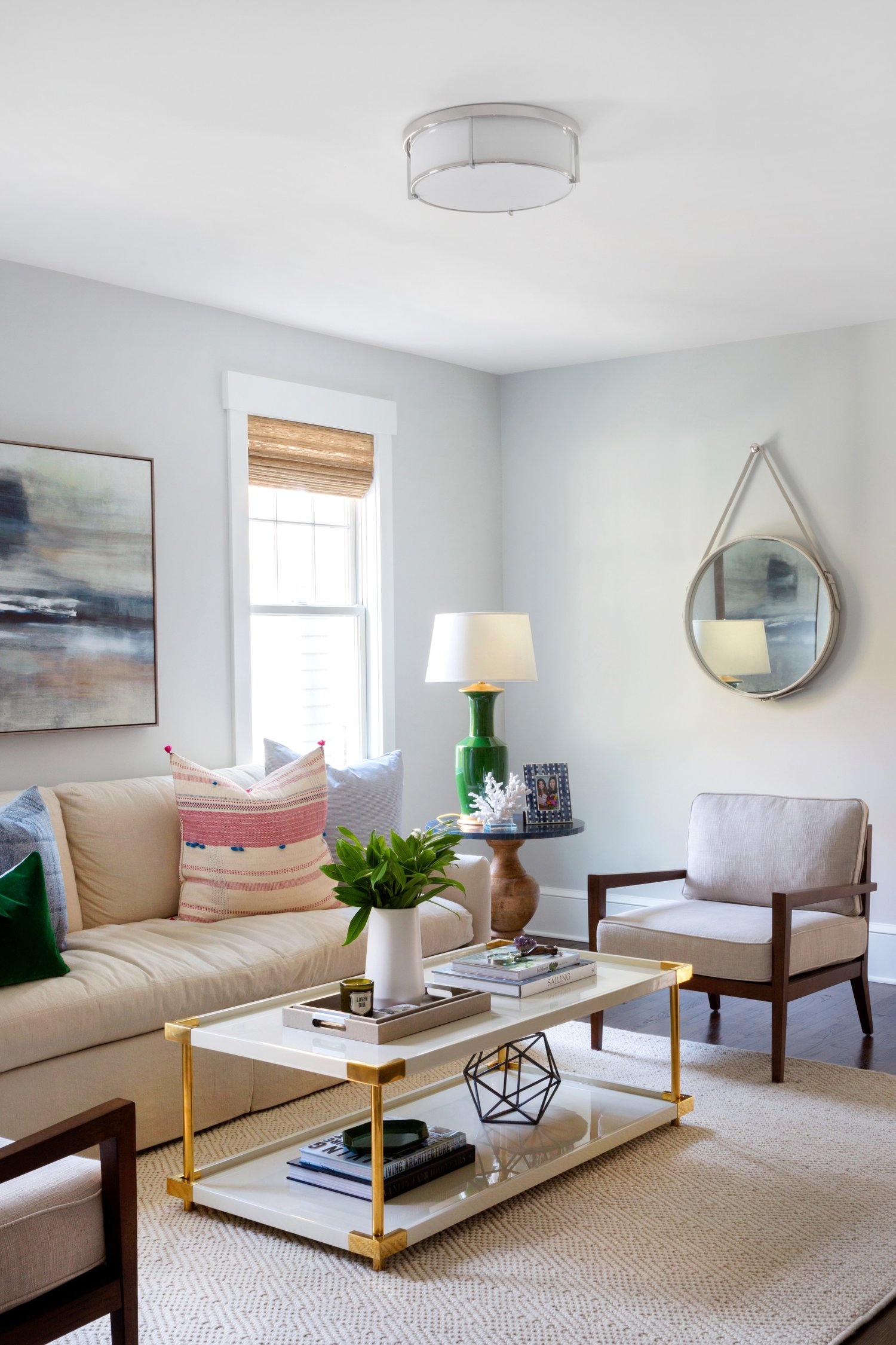Gold coffee table in front of white couch