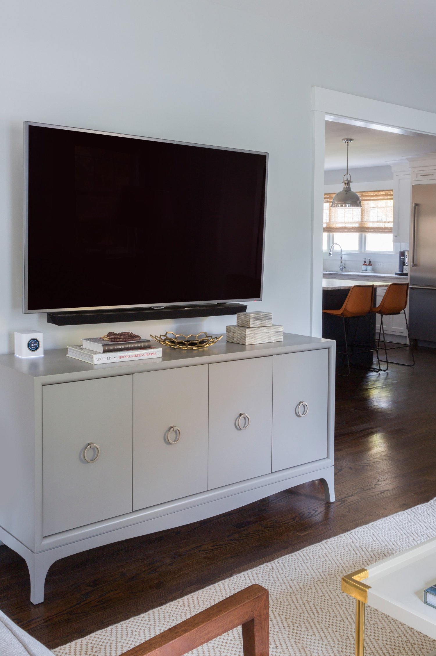 Flat screen TV above grey hutch