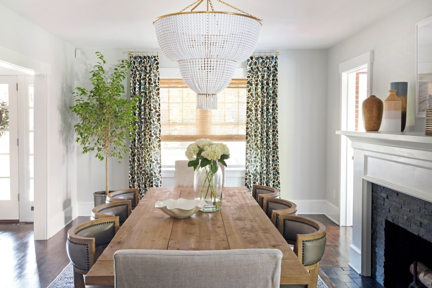 Dining room table in front of vertical window