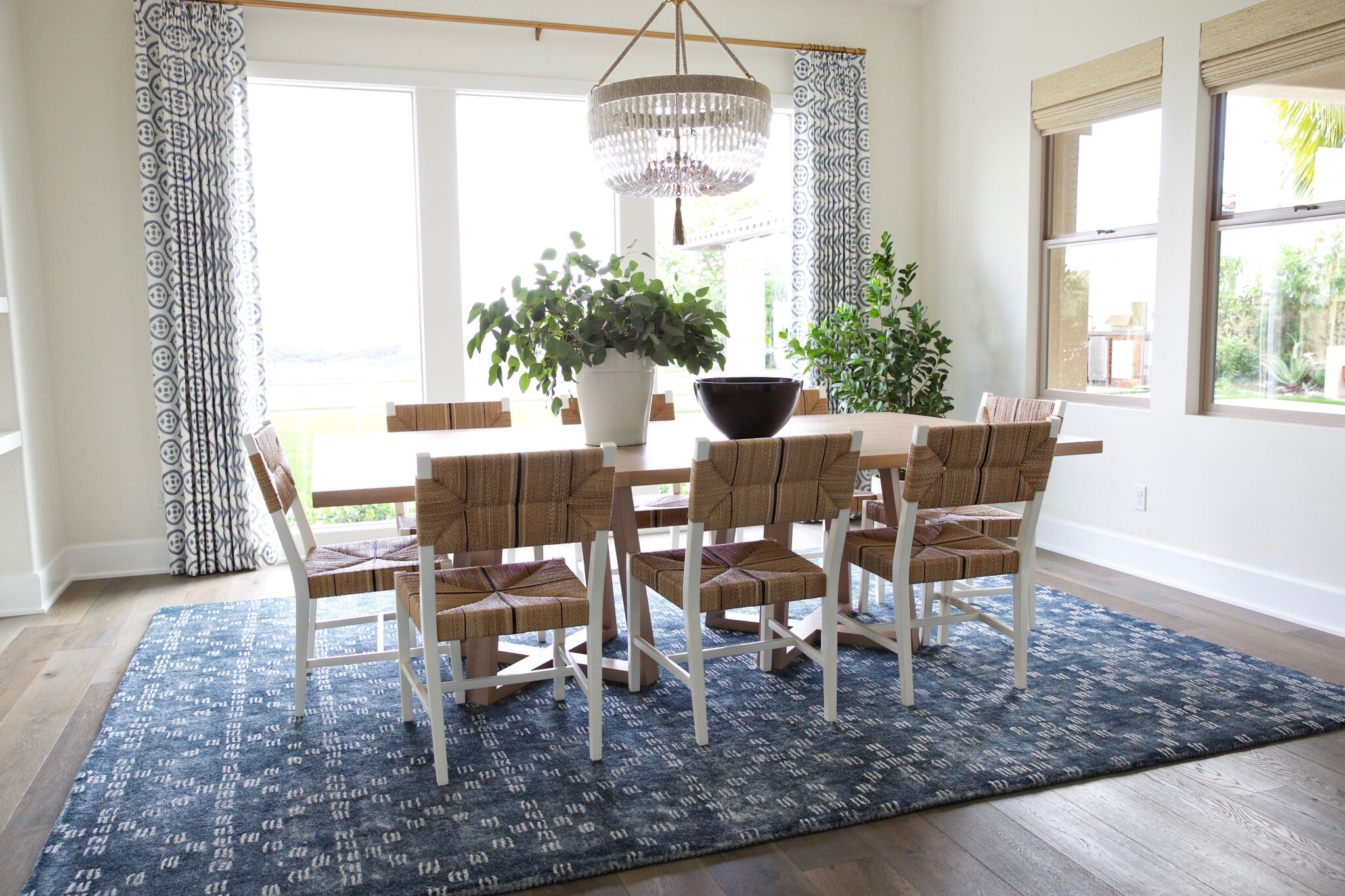 Large floor to ceiling windows behind table