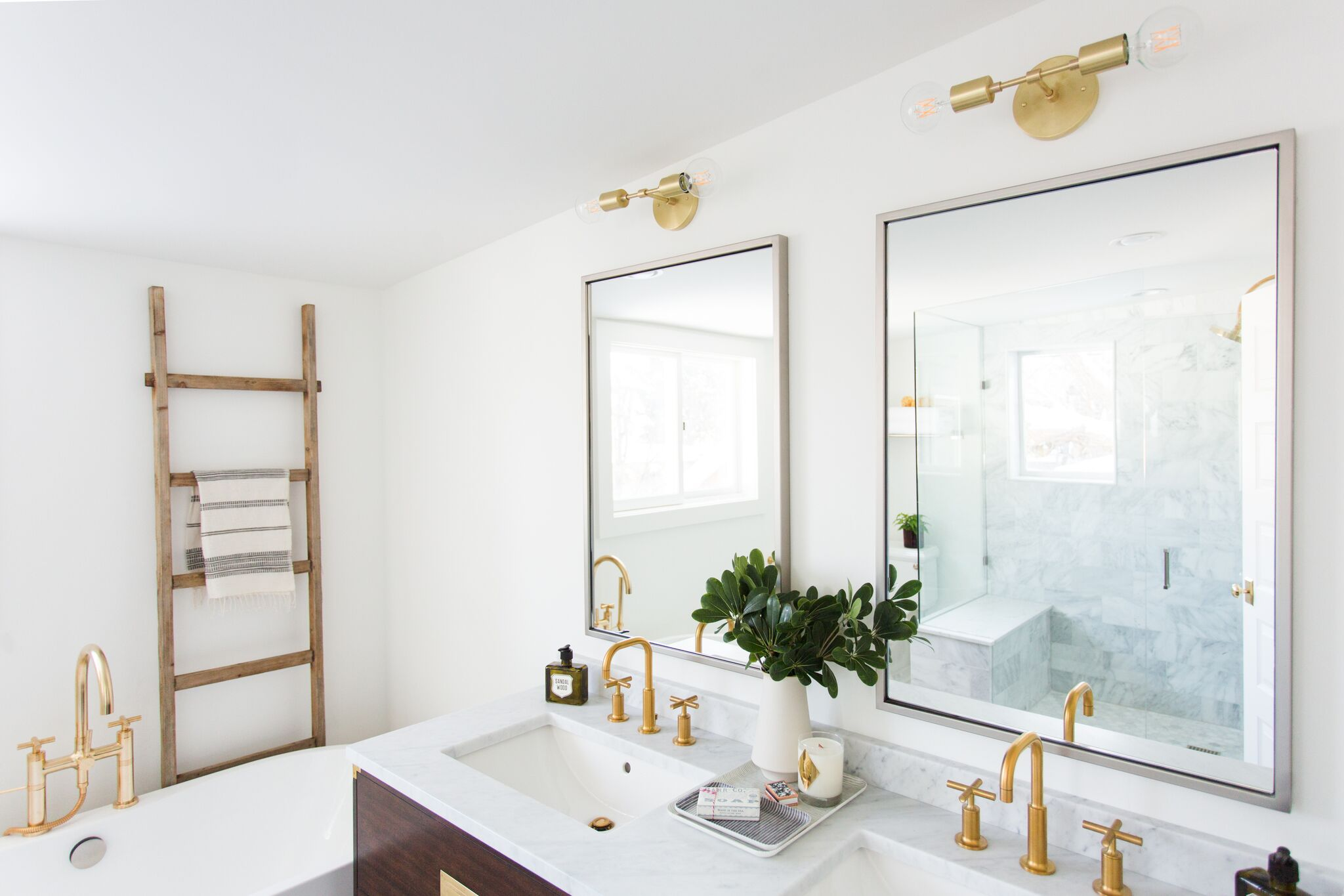 White modern bathroom with gold fixtures