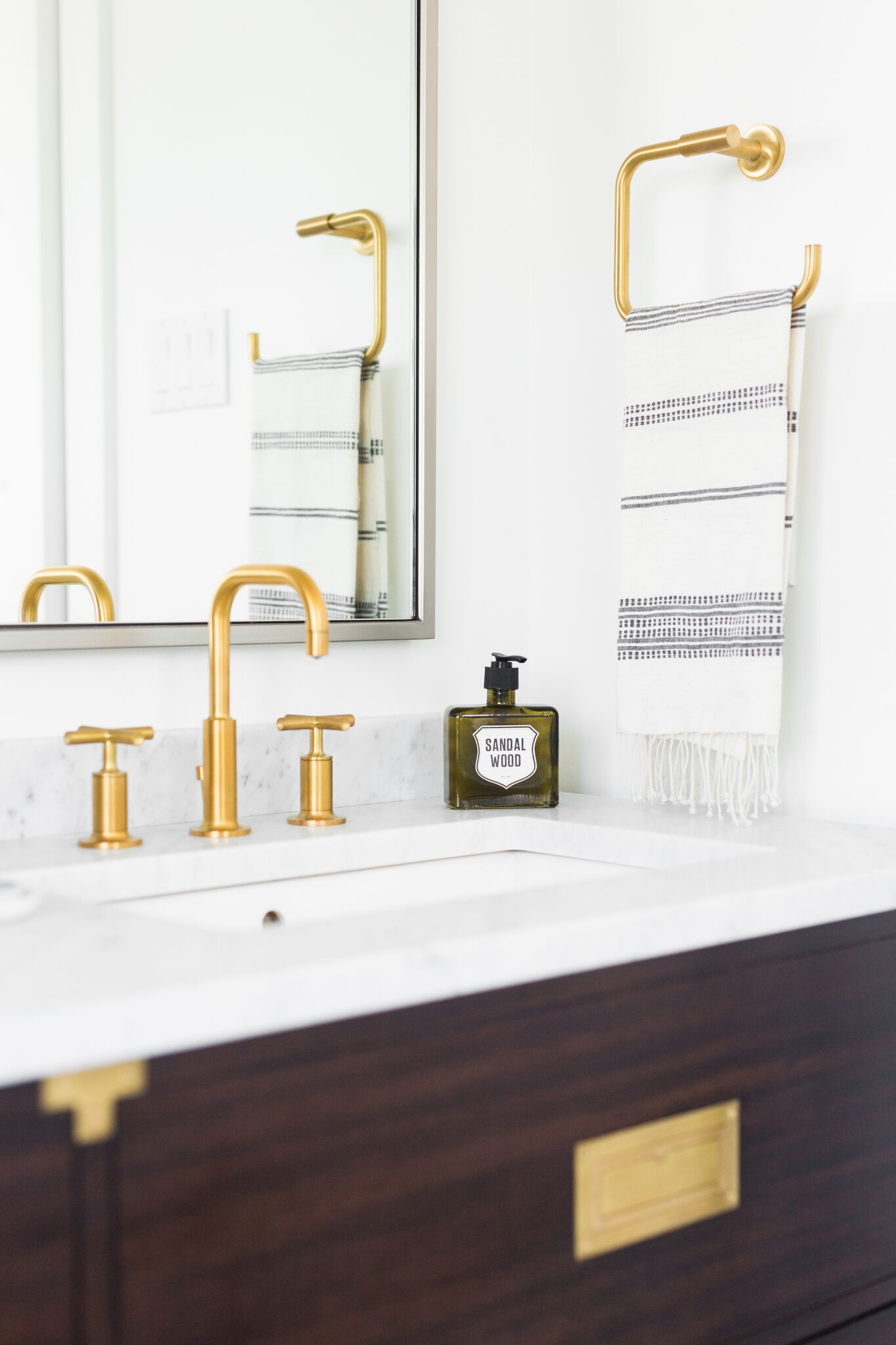 Detailed view of gold faucet in bathroom