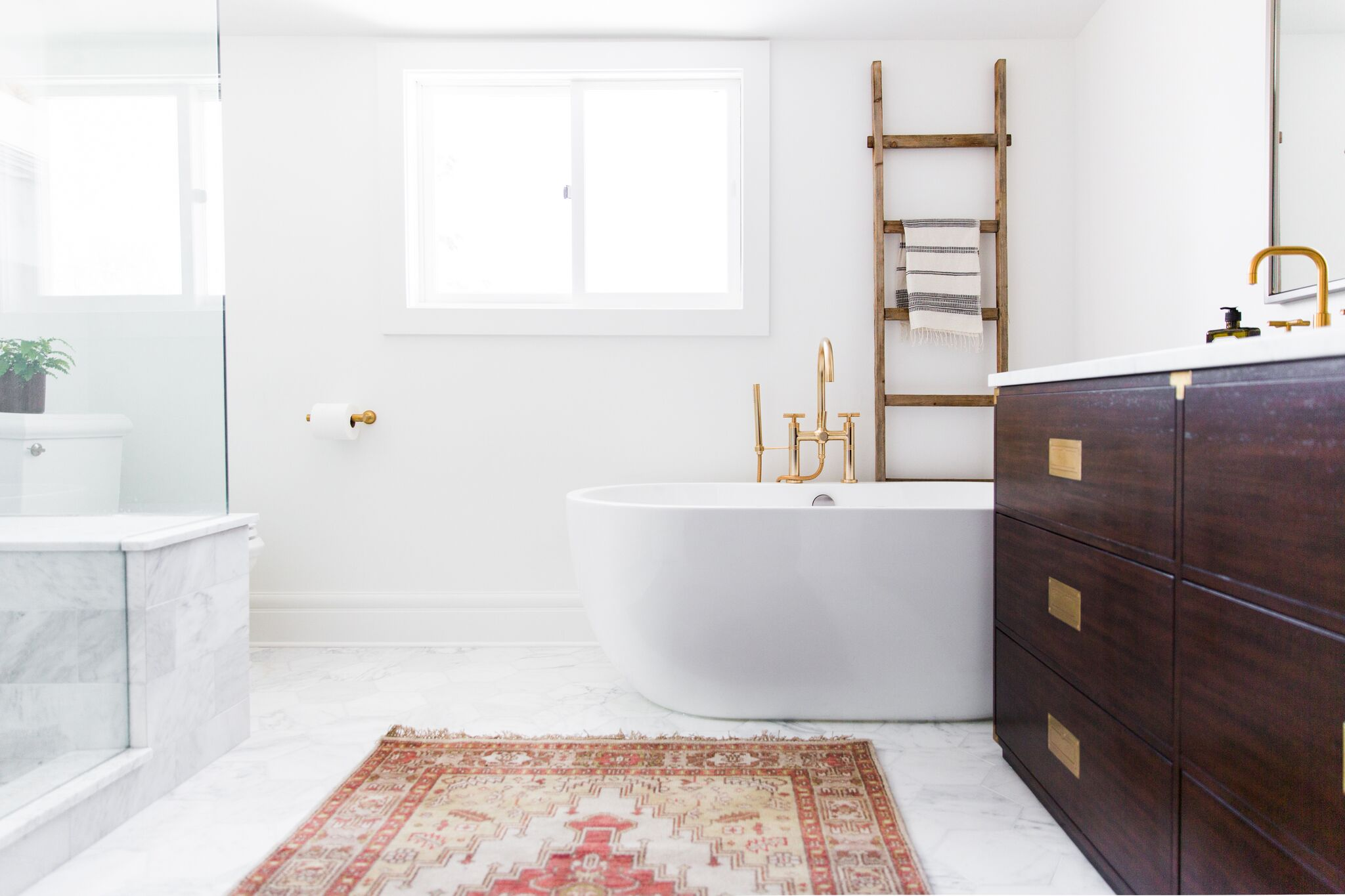 White statement bathtub in front of window