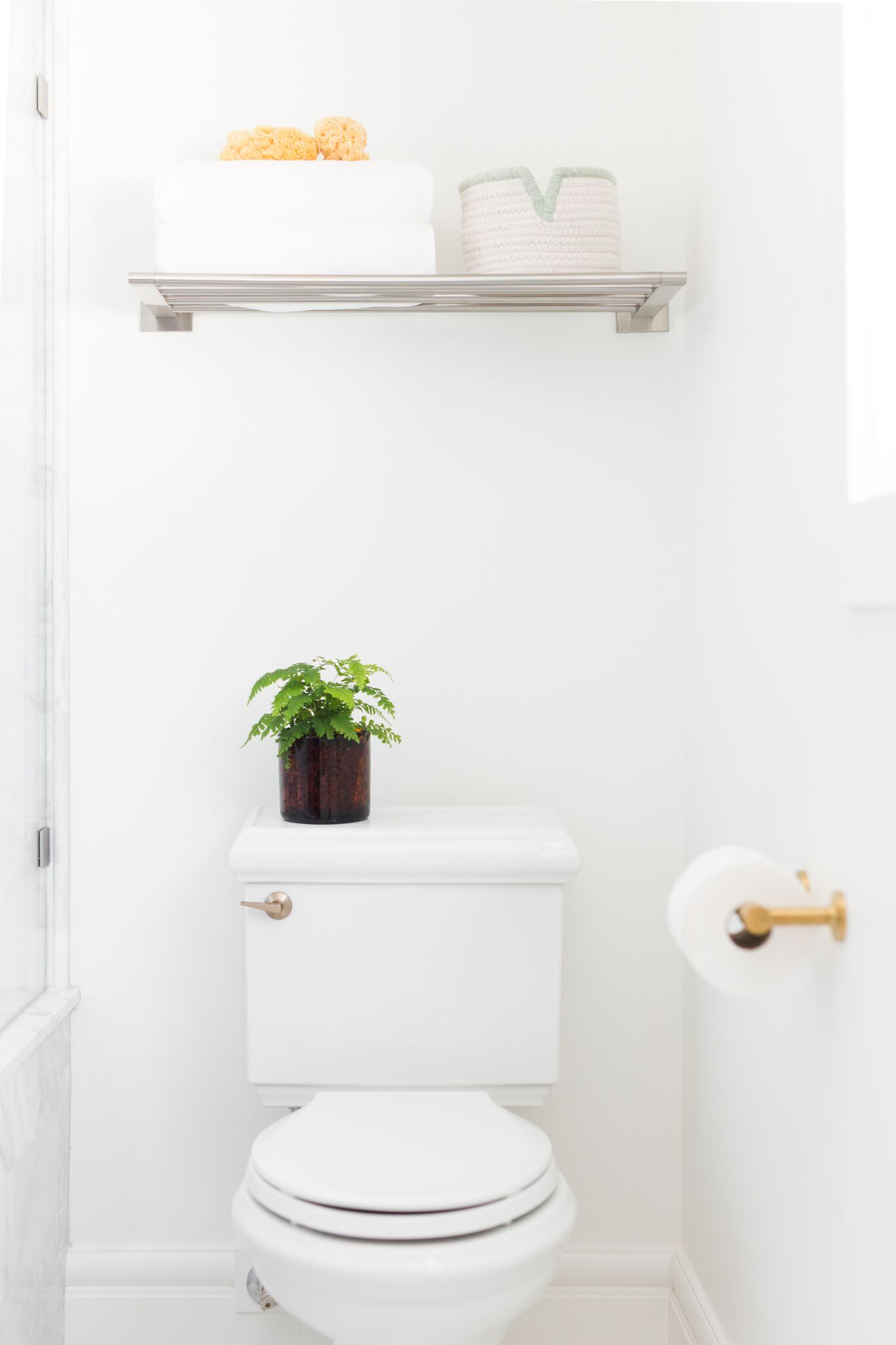 White toilet with decorative details