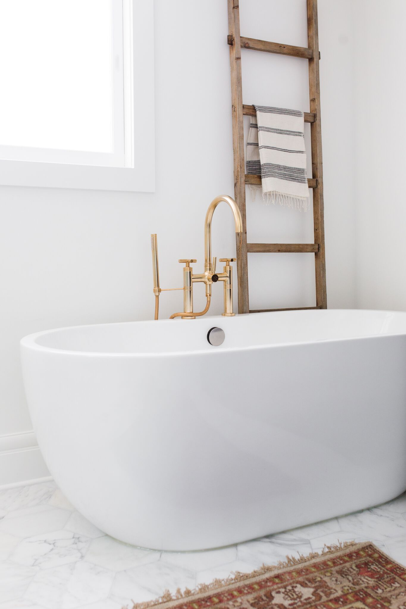 White porcelain tub in bathroom