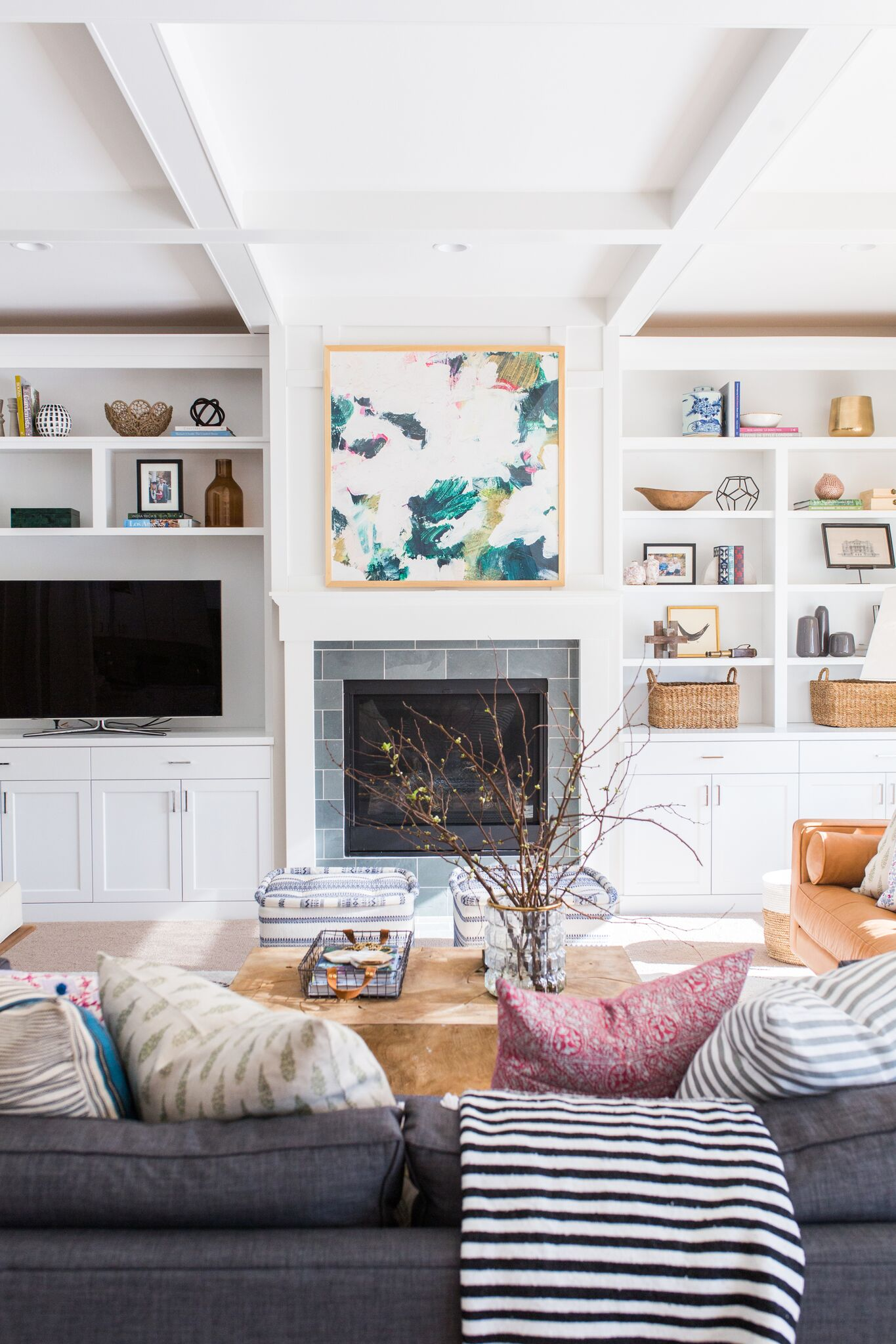 Flat screen TV and grey fireplace in living room