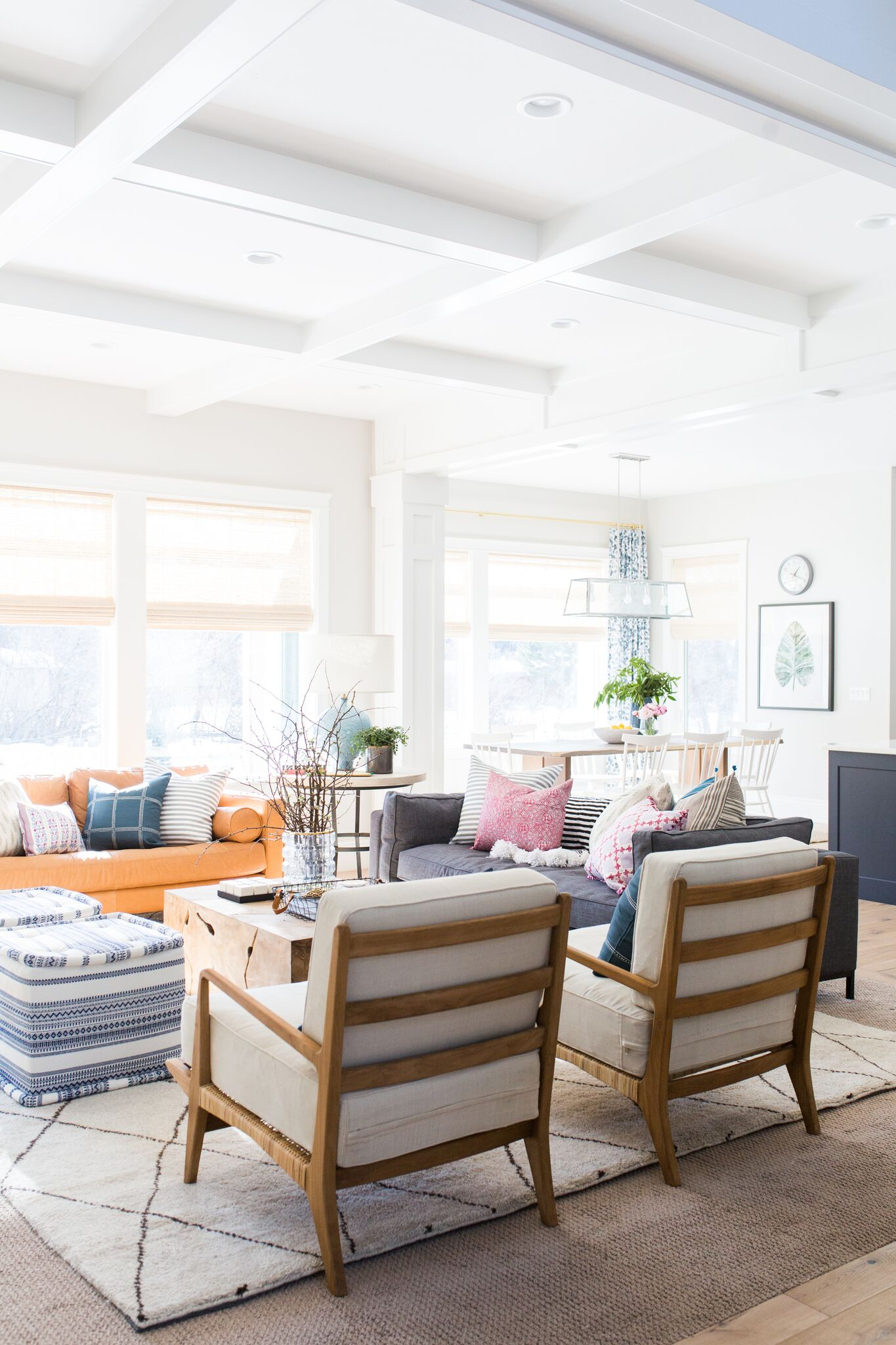 Back of white chairs with large area rug