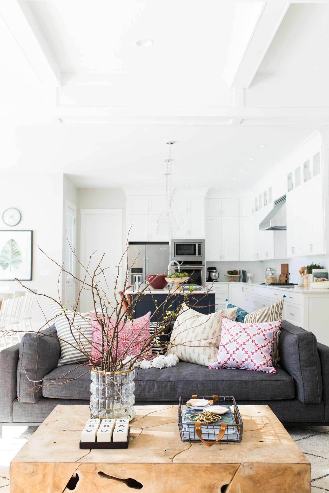 Large center coffee table in front of grey couch