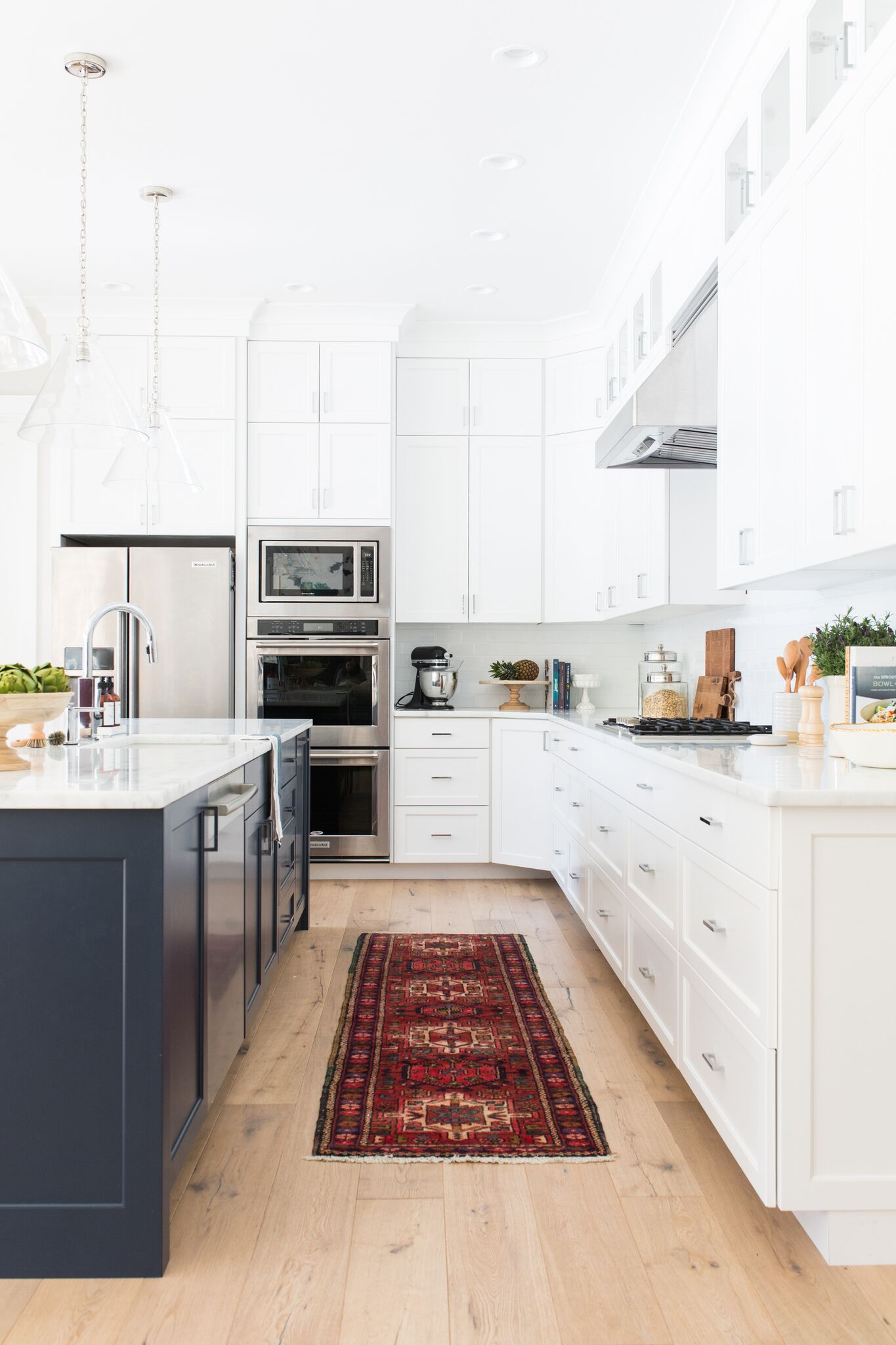 White and navy kitchen with red runner rug