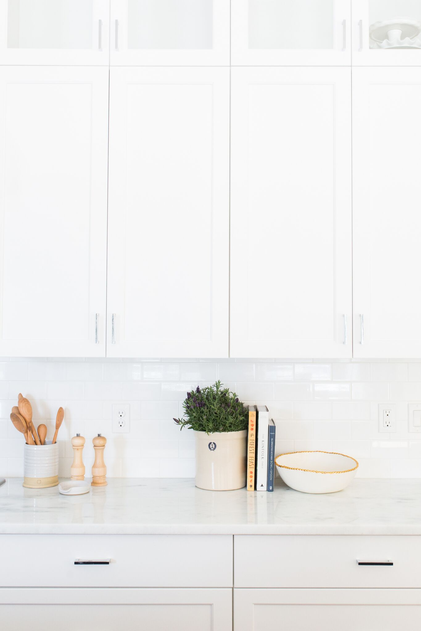 Plants and bowls on top of white counter top