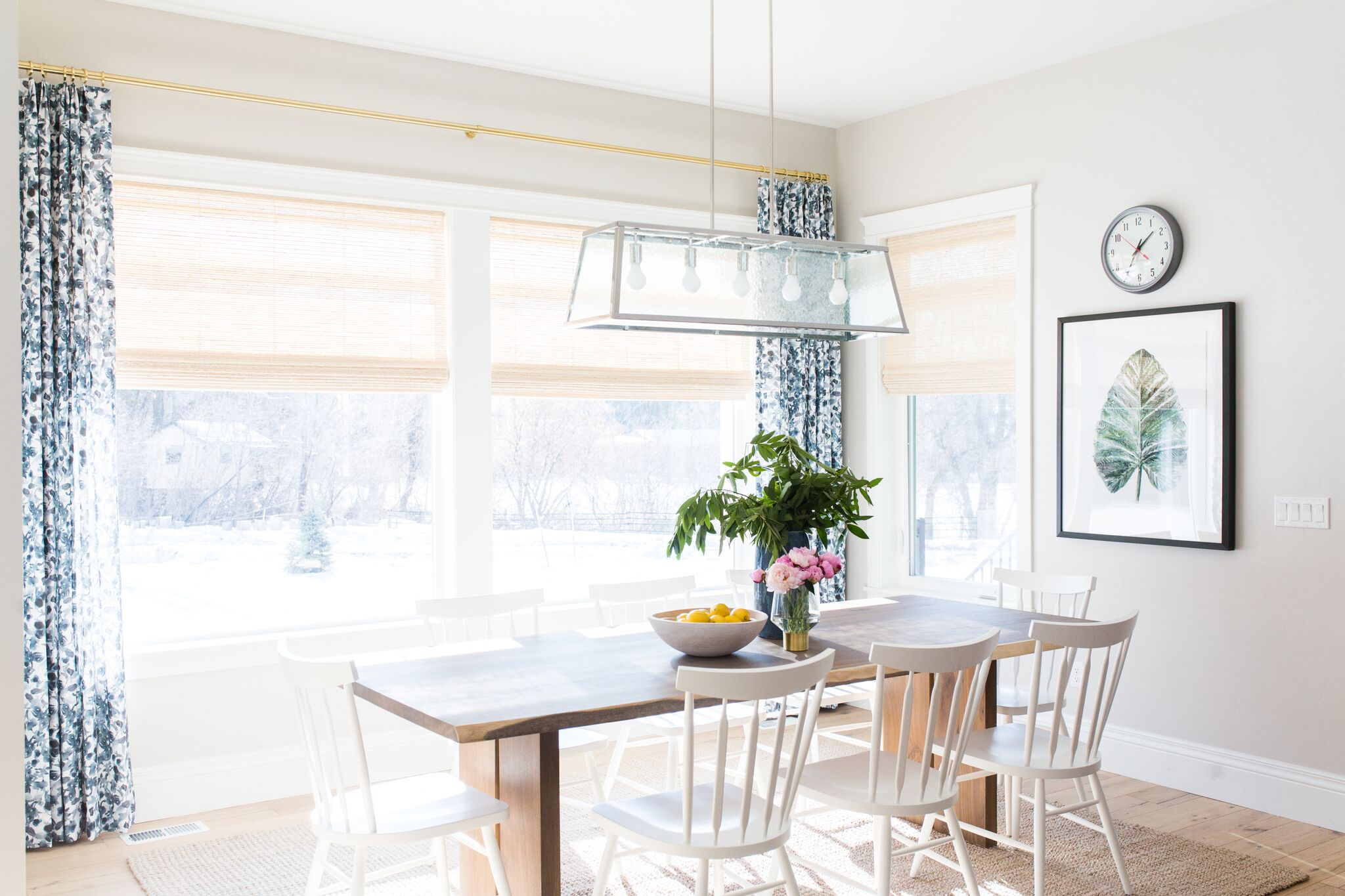 Wooden kitchen table with white kitchen chairs