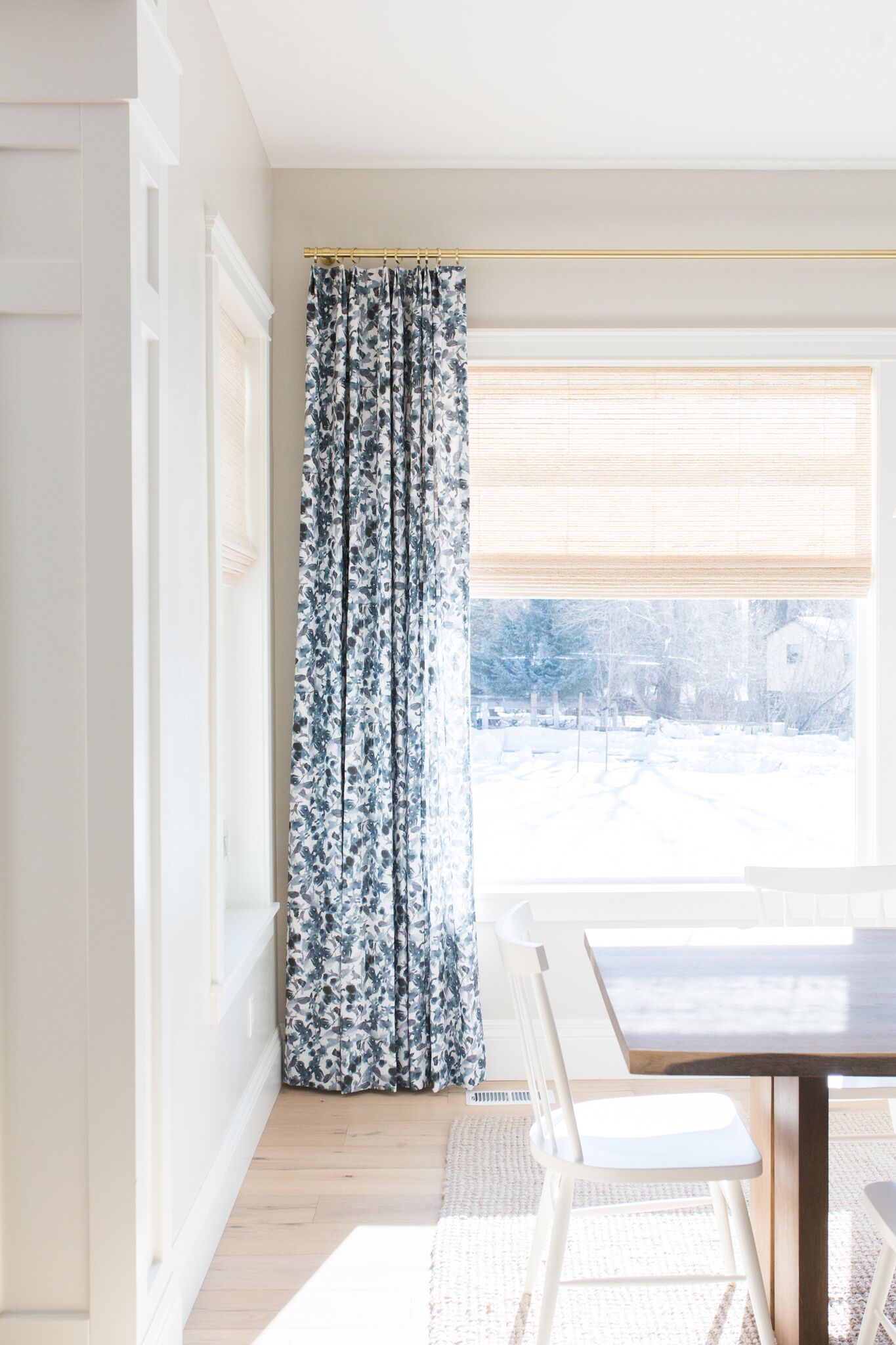 Kitchen dining area with blue and white curtains