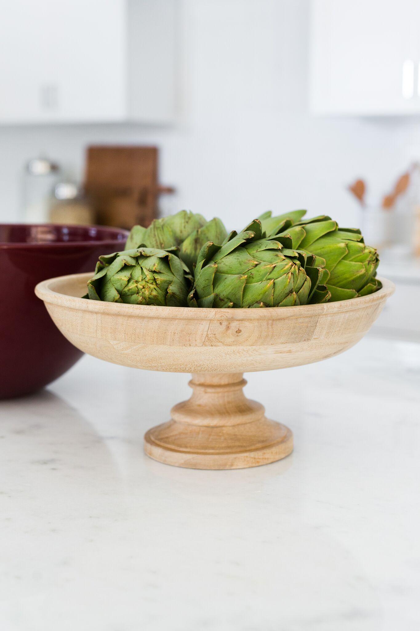 Bowl of artichokes on kitchen counter