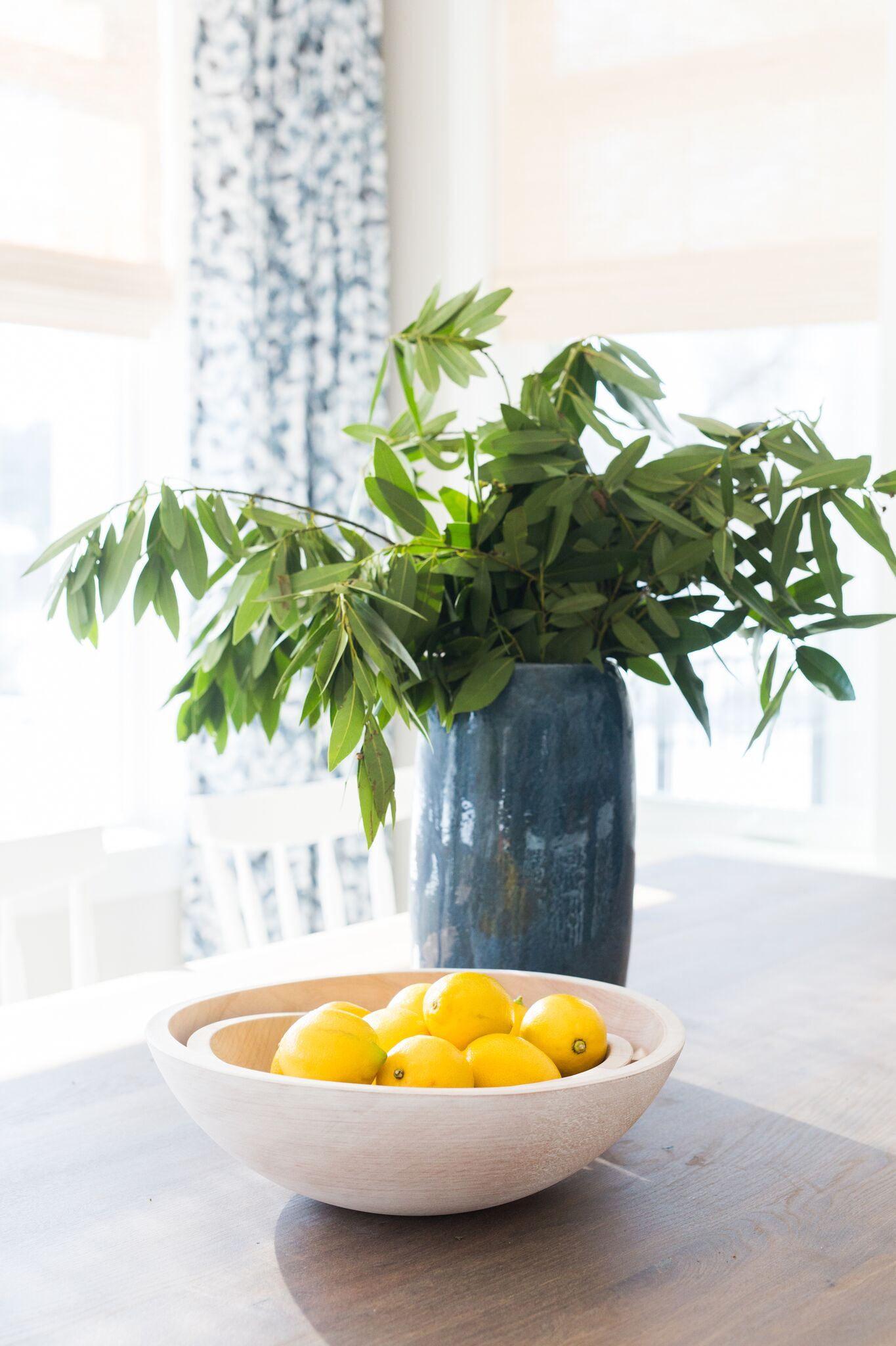 Bowl of lemons on top of counter