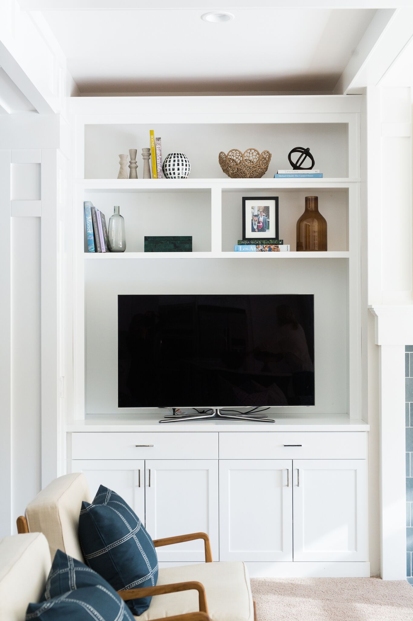 Flat screen TV on top of built in cabinets