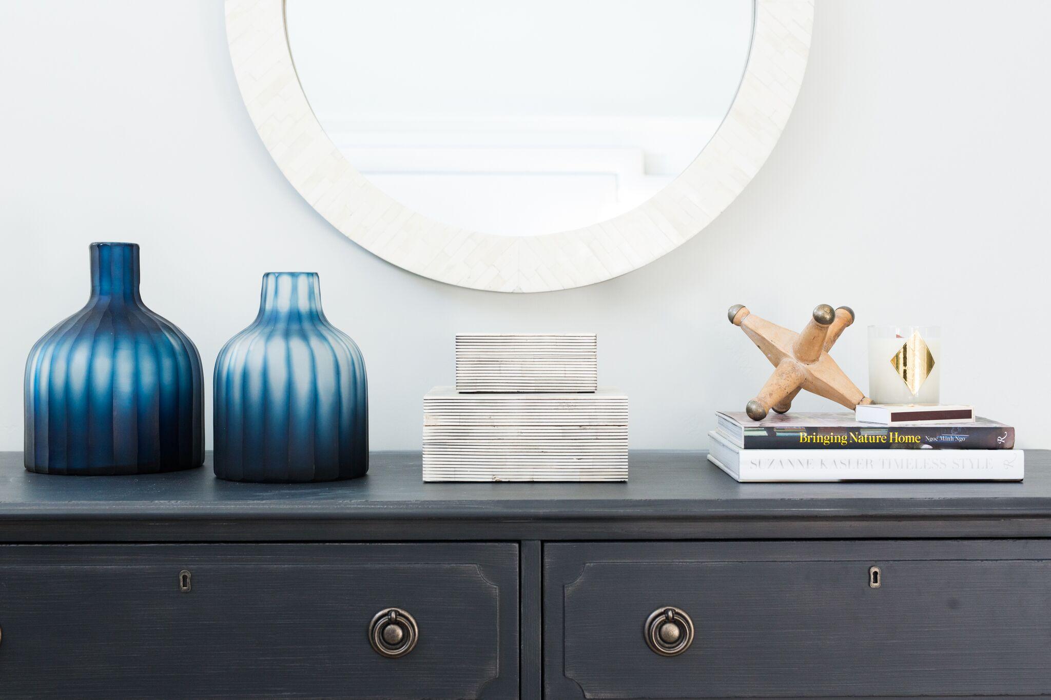 Black vanity with white mirror