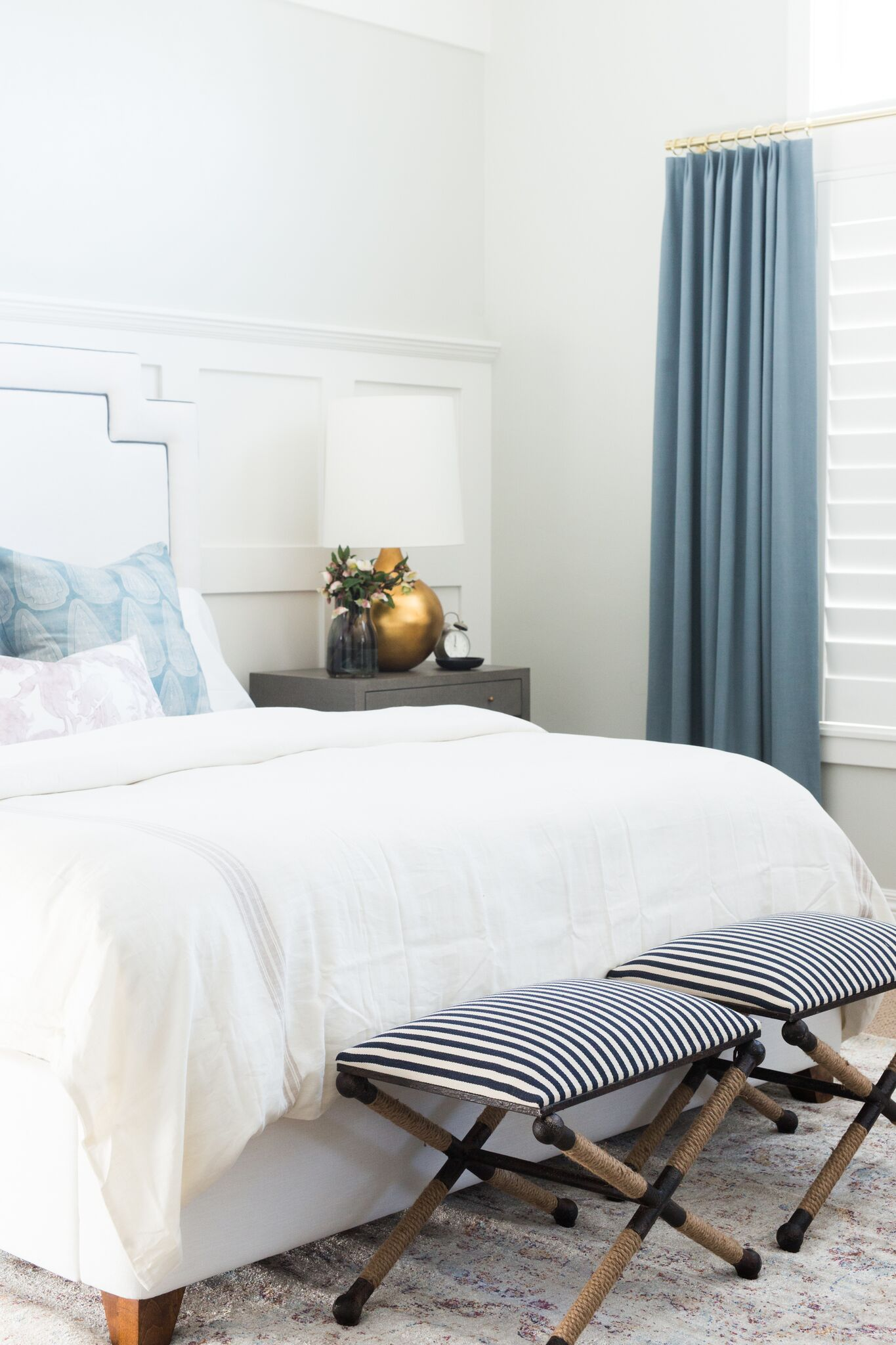 Master bedroom with blue curtains
