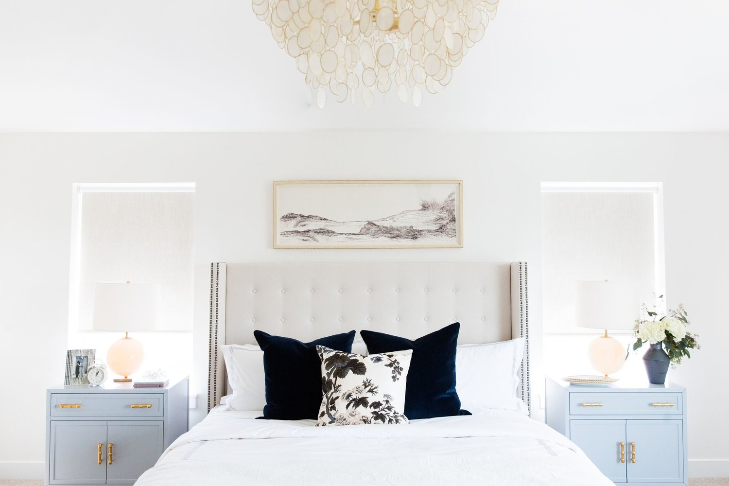 White bed with powder blue nightstand