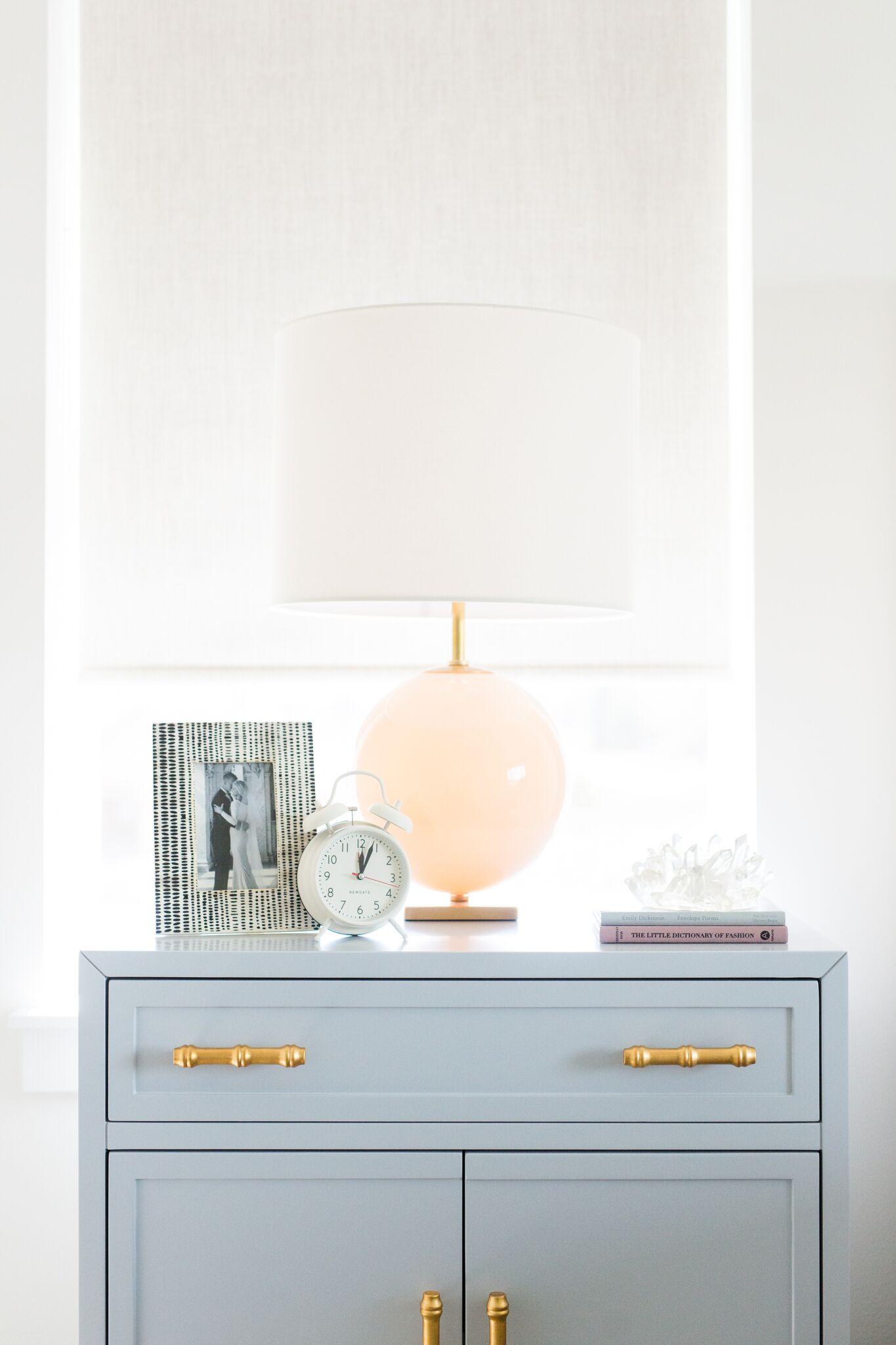 Peach lamp atop blue nightstand