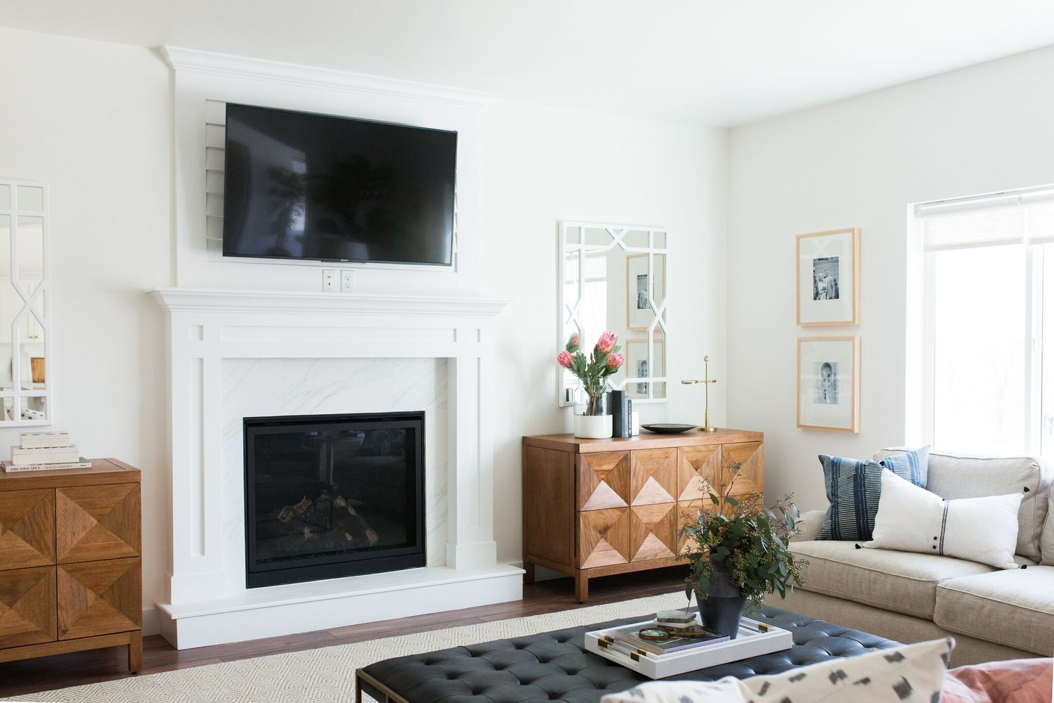 Flat screen TV mounted over fireplace