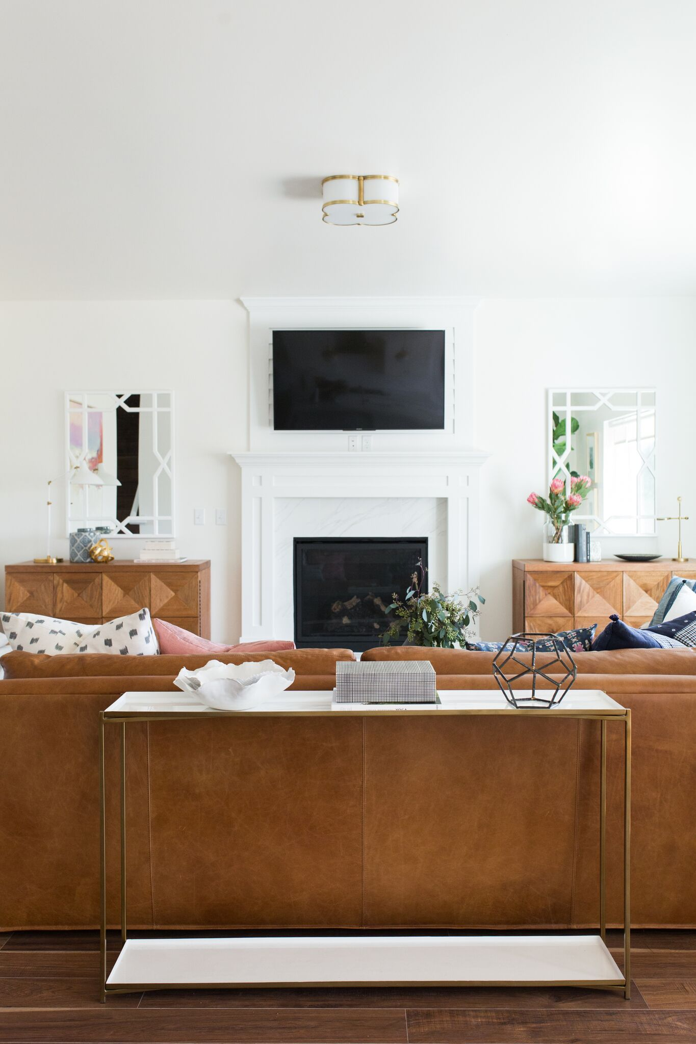 Brown table behind large sectional couch